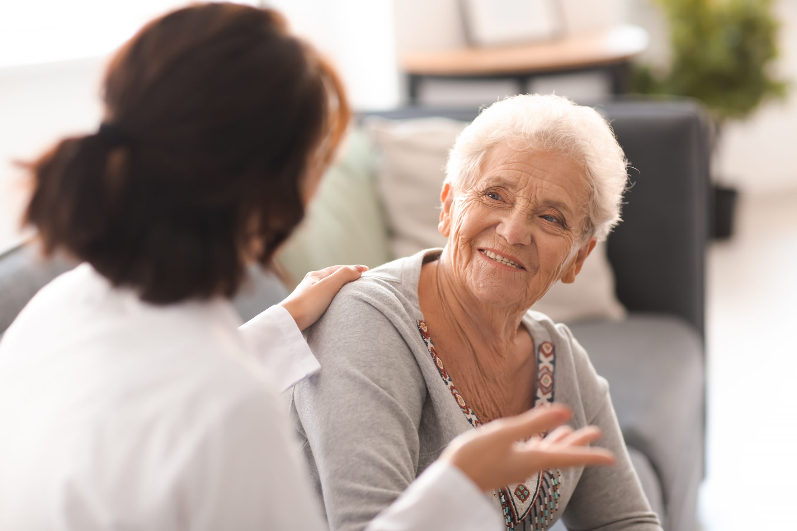 Career talking to a resident in a supported living environment