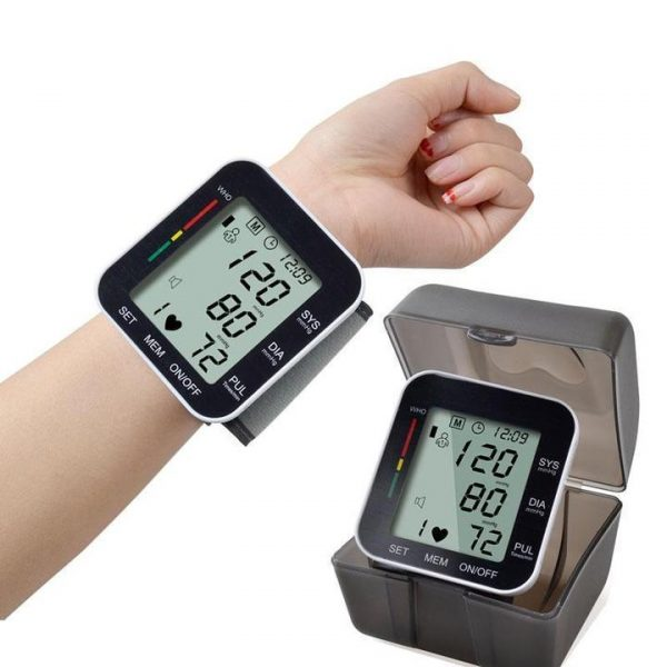 Person wearing wrist blood pressure monitor